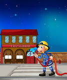 A fireman near a fire station. Illustration of a fireman near a fire station Stock Photo