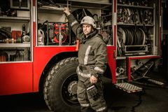 Fireman near firefighting truck Stock Photos