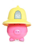 Fireman piggy bank. Studio cutout Stock Images