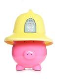 Fireman piggy bank Stock Images