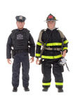 Fireman and a policeman dolls Stock Photography