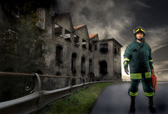 Fireman portrait. Fireman standig near burnt factory Royalty Free Stock Images