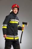 Fireman posing with an axe. Royalty Free Stock Photos