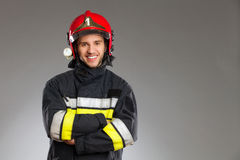 Fireman posing wth arms crossed. Royalty Free Stock Photo