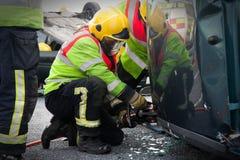 Fireman with Power Wedge at car crash Royalty Free Stock Photo