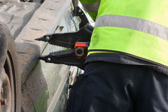 Fireman with Power Wedge at car crash, detail Royalty Free Stock Photo