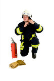 Fireman protective equipment. Fireman with safety and protective clothing and equipment including a fire extinguisher and gloves Stock Photo