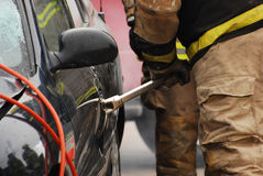 Fireman with pry bar. Royalty Free Stock Photos