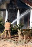 Fireman putting fire out Royalty Free Stock Photo