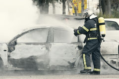 Fireman putting out Stock Images