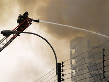 Fireman putting out a fire Stock Photo
