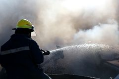 Fireman Putting Out Fire Royalty Free Stock Photography
