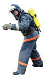 Fireman - Rescue in breathing apparatus. Fireman in front of the unfit for respiration environment gesticulating in front lifeguard stock photo