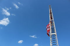 Fireman's ladder and American flag Royalty Free Stock Photography