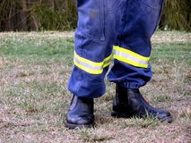 Fireman's Legs. Close up photo of Firemans legs in protective shoes stock images