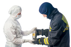 Fireman sends container with radiation chemist in the laboratory Royalty Free Stock Photos