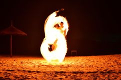 Fireman Show on the beach dance man juggling with swing fire spa. Rks in the night, Thailand stock image