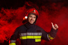 Fireman showing thumb up Stock Photos