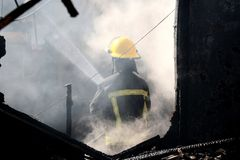 Fireman and Smoke in House Stock Photo
