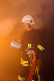Fireman in smokey room Stock Photos