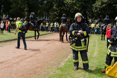 Fireman with special equipment at public event. VILNIUS, LITHUANIA - JULY 27: rescue teams fireman with special clothing and equipment through large public event Royalty Free Stock Photo