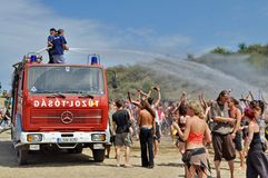 Fireman splashing water on the crowd on Ozora Fest Royalty Free Stock Image