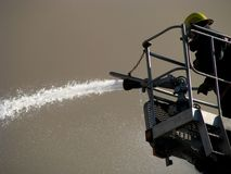 Fireman spraying water Stock Images