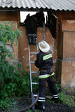 Fireman spraying water Royalty Free Stock Images