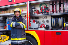 Fireman. Standing by fire engine,photography Royalty Free Stock Photo