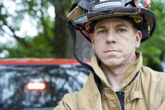 Fireman Stands by Truck Looking at Camera Stock Photos