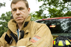 Fireman Stands by Truck Looking at Camera Royalty Free Stock Photos