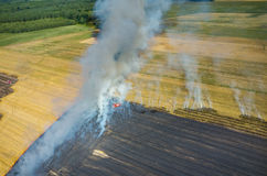 Fireman truck working on the field on fire Royalty Free Stock Image