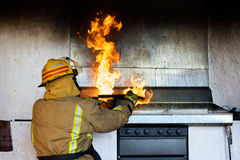 Fireman trying to put an oil fire Royalty Free Stock Photo