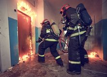 Firemans team during firefighting royalty free stock photography