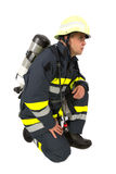 Fireman in uniform isolated Stock Photography