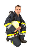 Fireman in uniform isolated Stock Images