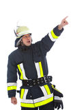 Fireman in uniform standing pointing Stock Photography