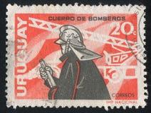 Fireman. URUGUAY - CIRCA 1966: stamp printed by Uruguay, shows Fireman, circa 1966 royalty free stock photo