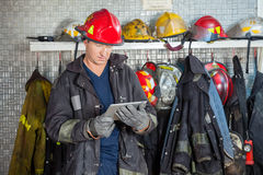 Fireman Using Digital Tablet At Fire Station Royalty Free Stock Photos