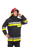 Fireman using phone. Royalty Free Stock Images