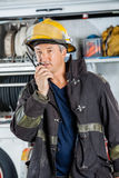 Fireman Using Walkie Talkie At Fire Station Royalty Free Stock Photography