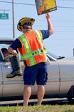 Fireman volunteer fundraising for MDA. Fireman volunteer fundraising for the Muscular Dystrophy Association by walking around a traffic intersection and people Royalty Free Stock Photography