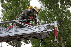 Fireman wearing a gas mask on the stairs Stock Image