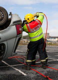 Fireman With Power Wedge At Car Crash Resque Stock Images
