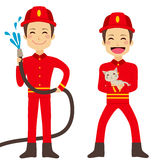 Fireman Working. Happy fireman working holding hose with flowing water and rescuing cat Royalty Free Stock Images
