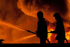Fireman. Working in the night at the explosion Stock Image
