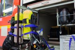 在一辆救火车的设备firemans的 免版税库存照片