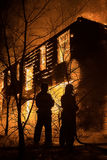 Firemans Trying to Safe House on Fire. Firefighter Emergency Ext Stock Photography