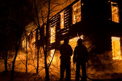 Firemans Trying to Safe House on Fire. Firefighter. Photo of Firemans Trying to Safe House on Fire. Firefighter Emergency Extinguish Water on Big Old Wooden Stock Photography