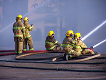 Firemen. Fighting a fire Royalty Free Stock Images